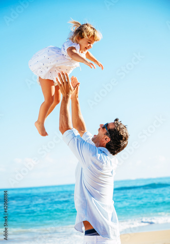 Father and daughter playing together at the beach