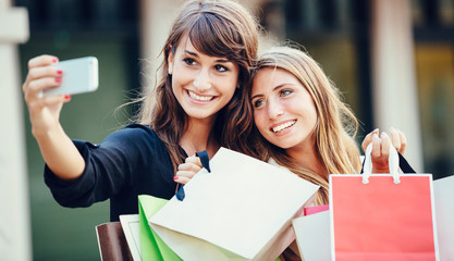 """Two young women shopping at the mall taking a """"selfie"""""""