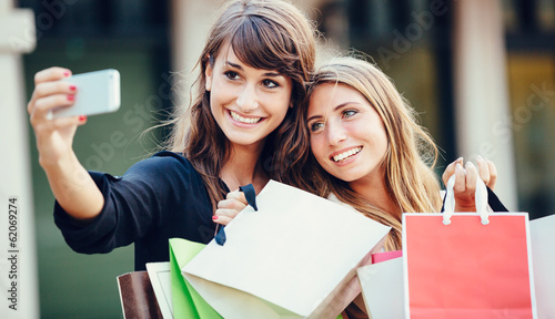 "Two young women shopping at the mall taking a ""selfie"""