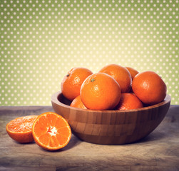 Tangerines in wooden bowl