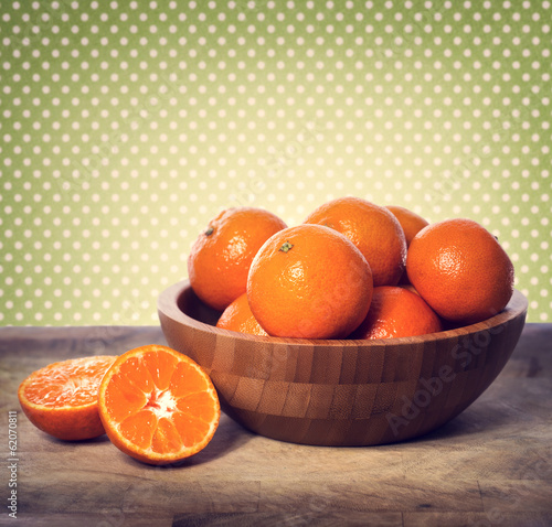 canvas print picture Tangerines in wooden bowl