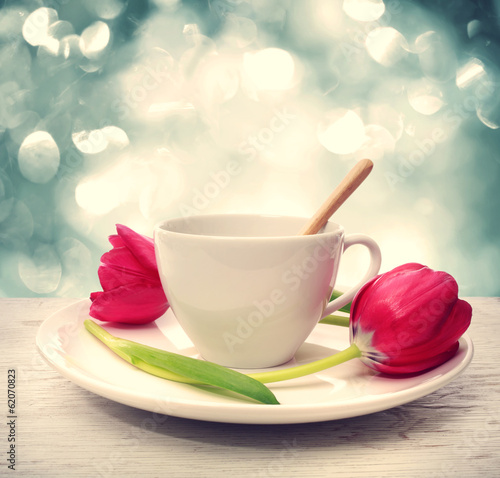 Coffee cup with red tulips