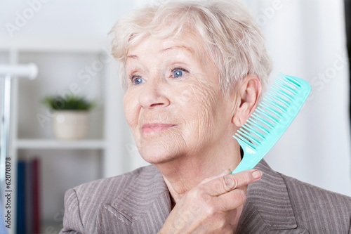 Senior lady combing hair