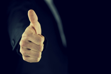 Thumbs up gesture of approval and success
