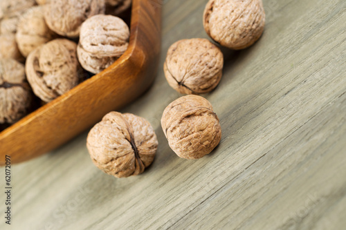 Close up of Whole Walnuts on Faded Wood