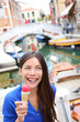 Ice cream eating woman in Venice, Italy