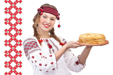 Girl with crepes on a national pattern