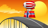 A floating balloon travelling wit the flag of Norway