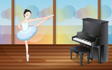 A ballerina dancing near the piano inside the studio
