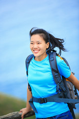 woman hiker enjoy the view seaside mountain peak