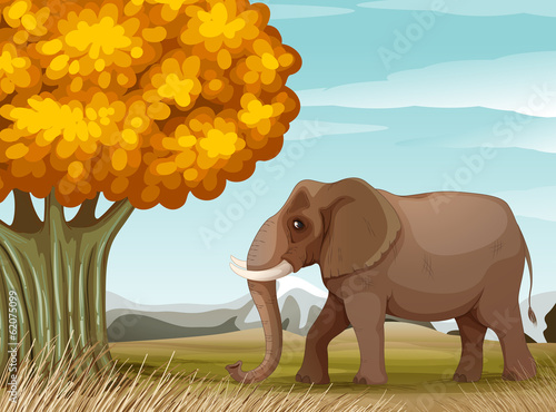 A big brown elephant near the big tree