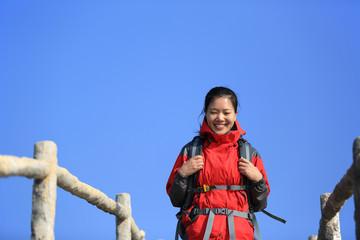 woman hiker mountain peak