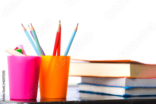 Pencils and book