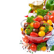 Assorted cherry tomatoes in a red colander, spices, olive oil