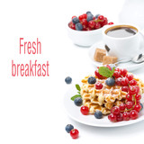 breakfast with Belgian waffle, berries and freshly brewed coffee