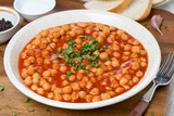 chickpeas in tomato sauce with fresh herbs