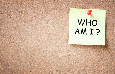 sticky pinned to corkboard with the phrase who am i?