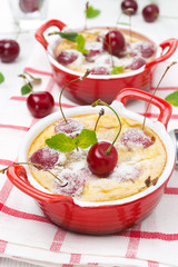 Casserole (clafoutis) with cherry in the ramekin