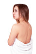 Pretty woman in towel pensive expression, body care portrait