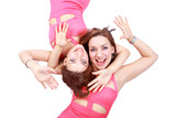Two playful laughing girls, swinging showing hands