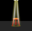 Light shines on empty stool on stage