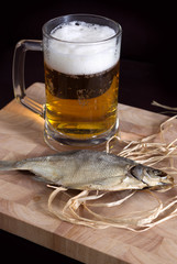 Dry fish with beer glass