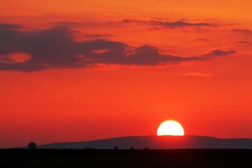 Orange - red sunset over horizont