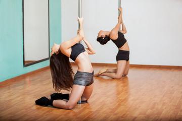 Women in a pole fitness class