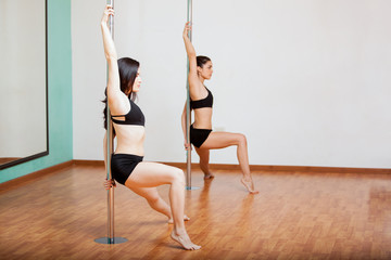 Pole dancing students in class