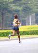 marathon athlete running on street