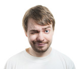 Man in t-shirt winking and smiling isolated on white.