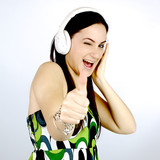 Happy cute girl listening music thumb up
