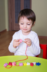 child playing with educational toys Lacing