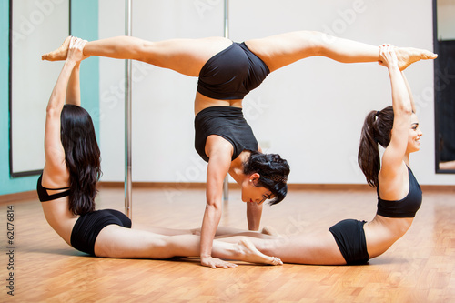 Sexy pole fitness group pose