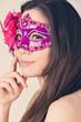 beautiful woman in a carnival mask