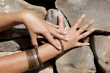 woman hands  with bracelet in the stone