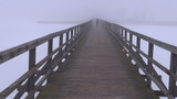 dark morning fog on wooden bridge and one schoolboy