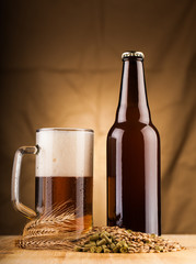 glass and bottle of home made  beer on table