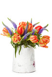Bunch of beautiful bright tulips in vase on white background