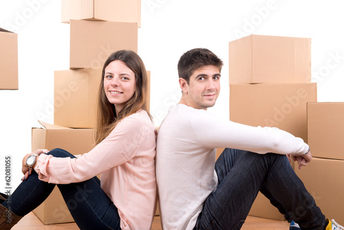 Happy couple with boxes