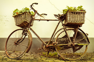 Retro styled image of an old bicycle with baskets