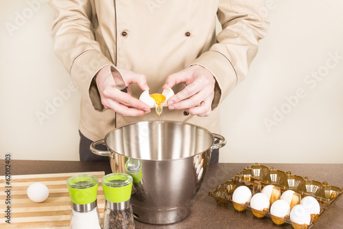 cook egg retrieves from the shell of