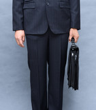 Formal wear closeup (man wearing suit and holding briefcase)