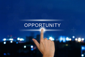 hand pushing opportunity button on touch screen