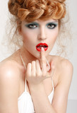 Portrait of a beautiful girl with fashion makeup - red lips, sty - 62084249