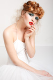 Portrait of a beautiful girl with fashion makeup - red lips, sty