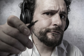 Jack, listening and enjoying music with headphones, man in white