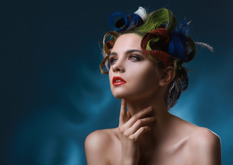 Fashion portrait of a beautiful model with fancy hairstyle