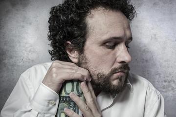 Penny-pinching, stingy businessman, saving money, man in white s