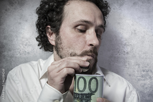 stingy businessman, saving money, man in white shirt with funny